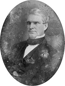 Nathan Kelsey Hall, half-length portrait, three-quarters to the left.jpg