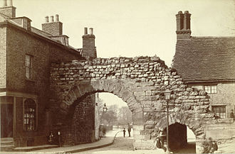 Newport Arch - Newport Arch in the second half of the 19th century. A brick building touched the west side of the arch. It was later razed and replaced with one standing further away, allowing for a pavement
