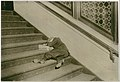 Newsboy asleep on stairs with papers, Jersey City, New Jersey MET DT221415.jpg