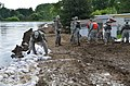 North Dakota National Guard places sandbags on a temporary in Minot, N.D..jpg