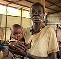 Nykuer Chol, 60, from Malakal waits for relocation to a camp in the Pagak Transit Centre (15136849945).jpg