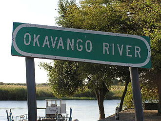 Okavango River - Sign overlooking a ferry crossing on the Okavango from Botswana into Namibia