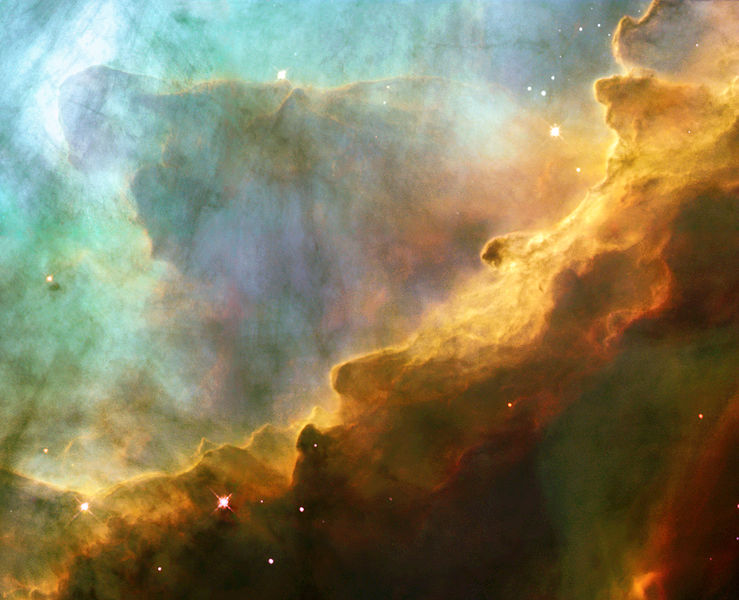 Boiling star formation clouds within Omega nebula