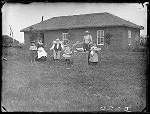 Omer Madison Kem - Omer Kem and his family in front of his sod house in Nebraska (1886)