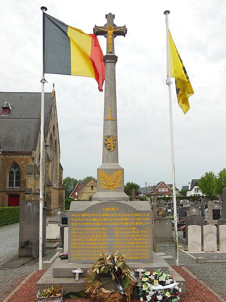 Column with crucifix, on a pedestal with names of victims of World War I and World War II