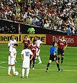 Ozil and Ronaldo set up for a free kick.jpg
