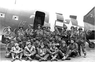 United States Army Pathfinder School - U.S. Army pathfinders pose in front of a C-47 before boarding the aircraft in order to parachute into France in support of the Normandy landings.
