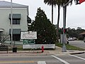 Perry City Hall sign and Christmas tree.JPG