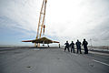 Personnel move a U.S. Navy X-47B Unmanned Combat Air System demonstrator aircraft onto the flight deck of the aircraft carrier USS George H.W. Bush (CVN 77) in Norfolk, Va., May 6, 2013 130506-N-YZ751-315.jpg