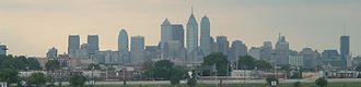 Curse of Billy Penn - View of Philadelphia skyline from Citizens Bank Park in 2004. William Penn's statue can be seen one-quarter from the right. Note height relationship to the newer buildings to the left.  The tallest building (with antenna) is One Liberty Place