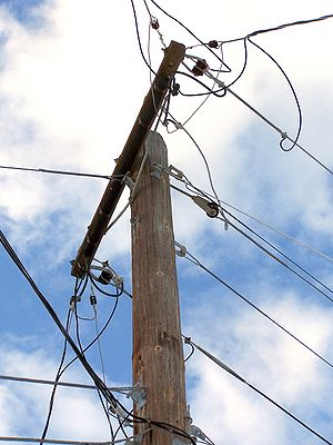 Telephone line - Utility pole with electric lines (top) and telephone cables.