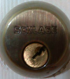 Lock picking - A deadbolt lock that has been picked, showing that the plug has been turned without the key.