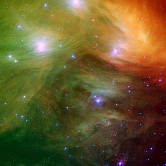 Pleiades - A Spitzer image of the Pleiades in infrared, showing the associated dust (Merope Nebula). Credit: NASA/JPL-Caltech