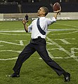 President Barack Obama throws a football (cropped1).jpg