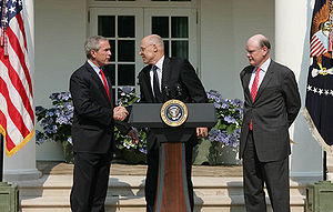 President George W. Bush shakes the hand of He...