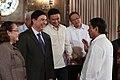 President Rodrigo Duterte chats with Health Secretary Paulyn Jean Ubial, Senator Ralph Recto, and Senator Sonny Angara following the ceremonial presentation of the signed IRR of the Centenarians Act.jpg
