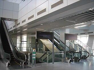 Punggol LRT line - Concourse level of Punggol MRT/LRT station, with escalators leading up to the LRT platform.