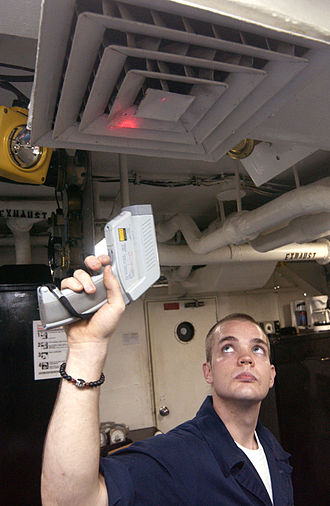 Pyrometer - A sailor checking the temperature of a ventilation system.
