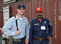Quartermaster Third Class Simmons Smiles With a Pakistani Police Officer DVIDS11683.jpg