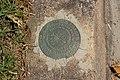 Quitman No2 1935 geodetic marker, N Madison St curb.jpg