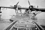 Refueling 20 Squadron RAAF Catalina at Darwin Aug 1944 AWM P01630.019.jpg