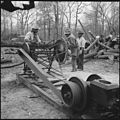 Rohwer Relocation Center, McGehee, Arkansas. Voluntary workers cutting up cleared logs for stove wo . . . - NARA - 538907.jpg