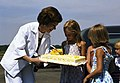 Rosalynn Carter with her Birthday Cake and Young Girls.jpg