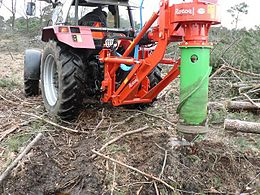 A Vertical Stump Grinder In Use