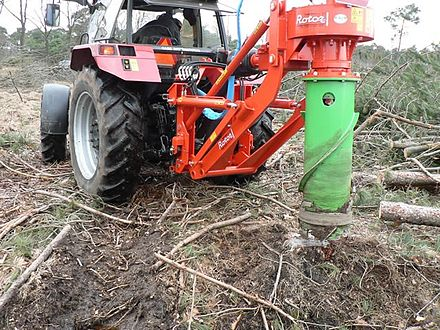 A stump grinder working to remove a tree stumps. - Plantation