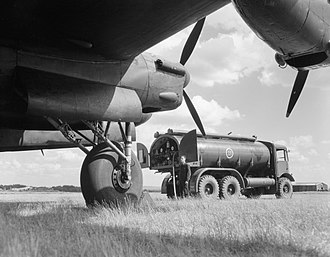 Operation Robinson - A fuel bowser completes the refueling of a Lancaster