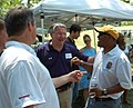 Rushern Baker 20120630 294 Co Exec Rushern Baker (yellow hat) (7507216830).jpg
