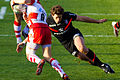 ST vs Gloucester - Luke Burgess tackling.jpg