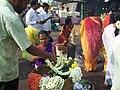 Samayapuram Mariyamman Temple - Flower Seller in the Entrance.jpg