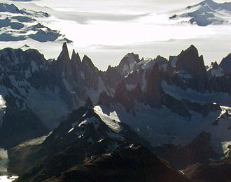 Col - Heavily notched massif of Cerro Torre and Fitz Roy