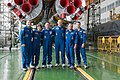 Soyuz TMA-13M crew and backup crew in front of their booster rocket.jpg