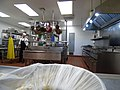Starr-150403-0415-Lactuca sativa-kitchen and Thai guy-Clipper House Sand Island-Midway Atoll (25276661175).jpg