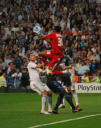 Steve Mandanda - Mandanda challenging for the ball against Real Madrid in 2010