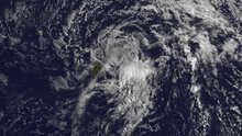 A visible satellite image depicting a degenerating tropical cyclone offshore Hawaii on July 29.
