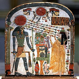Painted wood panel showing a woman with arms upraised toward a man with a falcon's head and a sun-disk crown. Chains of flowers-like shapes radiate from the disk toward the woman's face.