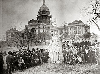 Texas State Capitol - Statue of the Goddess of Liberty on the capitol grounds prior to installation on top of the rotunda as construction is completed, 1888