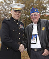 The Assistant Commandant of the Marine Corps, Gen. John M. Paxton, Jr., left, poses for a photo with a Marine veteran during an Honor Flight event at the Marine Corps War Memorial in Arlington, Va., Sept 131112-M-KS211-002.jpg