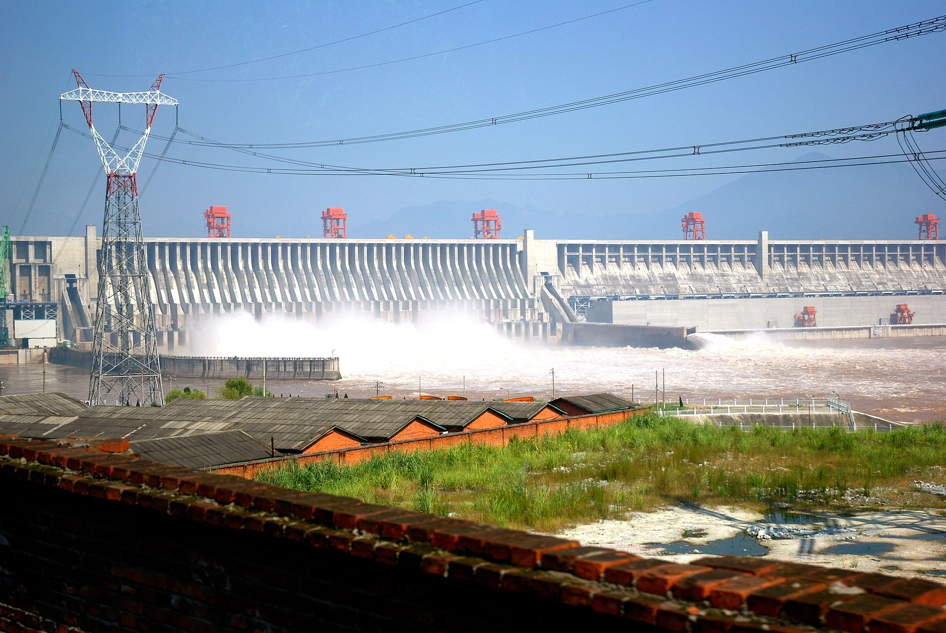 the gorges dam The three gorges dam, situated in the yichang, nearby the xiling gorge, is the biggest dam in china and the world's largest hydroelectric station for the usage of the flood control and power generation.