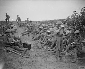2nd Infantry Division (United Kingdom) - Men of No. 1 Platoon, A Company of the 10th (Service) Battalion, Duke of Cornwall's Light Infantry, the divisional pioneers, breakfasting on their way to the line. Near Le Quesnoy, France, 27 October 1918.
