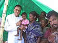 The Minister for Youth Affairs and Sports Shri Sunil Dutt with Tsunami victims at a relief camp in Chennai, on January 6, 2005.jpg