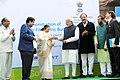 The Prime Minister, Shri Narendra Modi handing over the key of Retrofit Electric Bus to the Speaker, Lok Sabha, Smt. Sumitra Mahajan, at a function, at Parliament House, in New Delhi on December 21, 2015.jpg