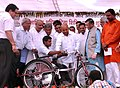 The Union Minister for Social Justice and Empowerment, Shri Thaawar Chand Gehlot distributing the assistive devices to disabled person, at a function, in Bareilly, Uttar Pradesh.jpg