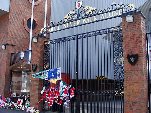 The You'll Never Walk Alone gates with flowers and scarfs