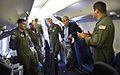 The flight crew of a U.S. Navy P-8A Poseidon briefs Secretary of Defense Chuck Hagel, second from right, as he visits the Patrol Squadron 30 training center at Naval Air Station Jacksonville, Fla., on July 16 130716-D-NI589-1591.jpg