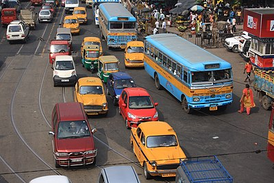 A road in Kolkata showing buses, taxis, auto rickshaws, cars, and other modes of road transport Traffic in Kolkata.jpg