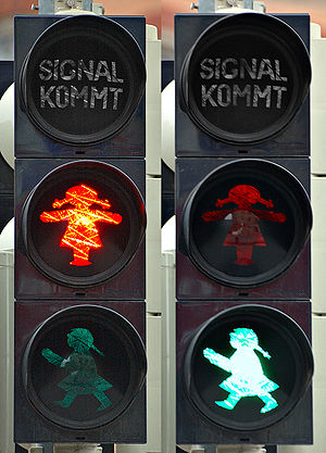Crosswalk signal feature showing a female pict...